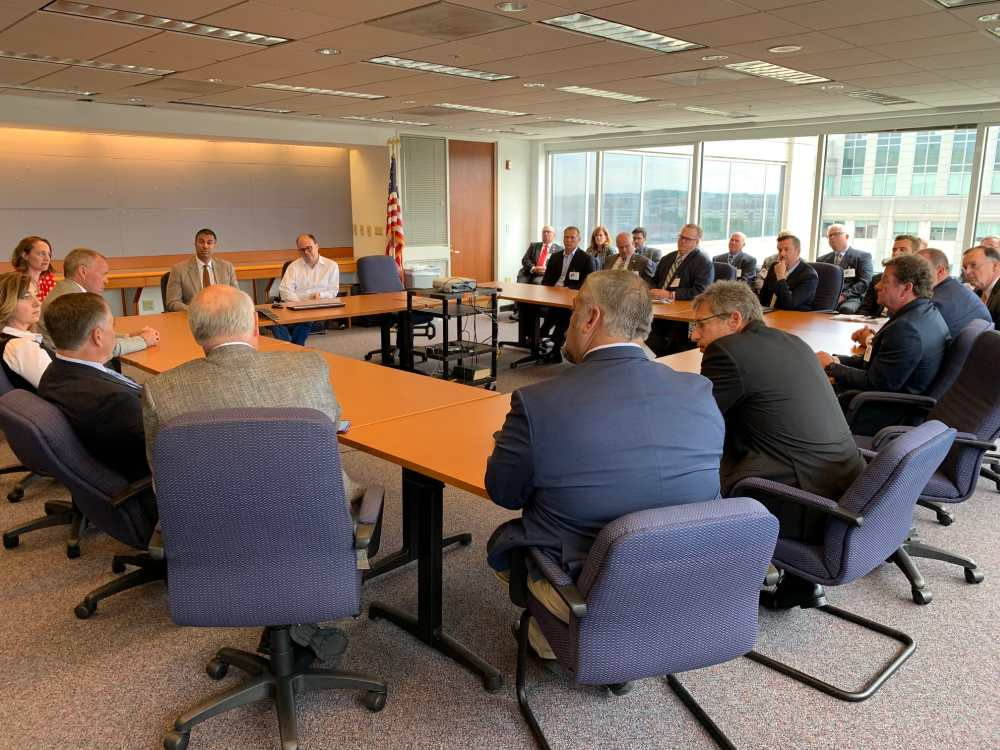 Chairman Pai and FCC staff meet with a large group of electric cooperatives